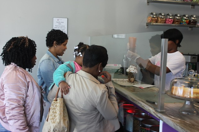 Customers watch a shake being made. - PHOTO BY SARAH FENSKE