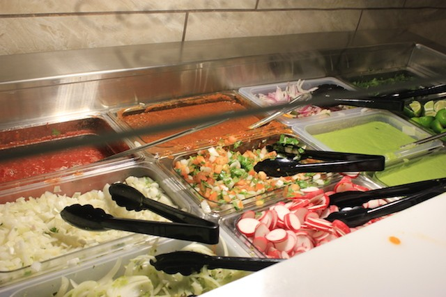 The salsa bar is unusually extensive, with a host of toppings, including fresh vegetables and limes. - PHOTO BY SARAH FENSKE