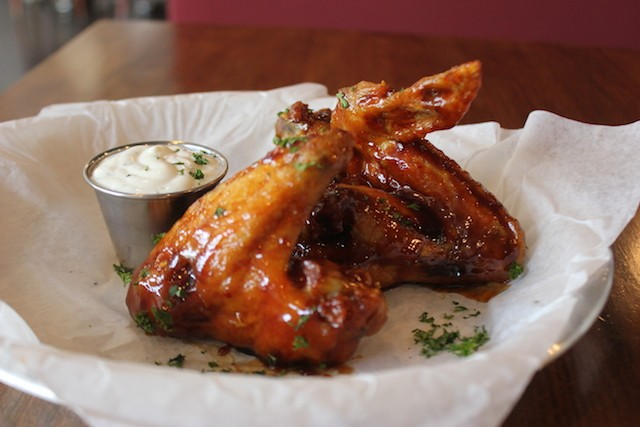Wings are three times the size you're used to, and served with a side of creamy blue cheese. - PHOTO BY SARAH FENSKE