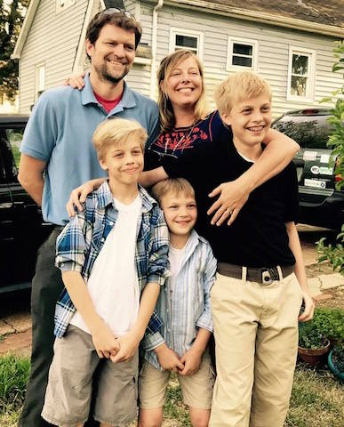 Megan Rieke, center, with her husband and three sons.