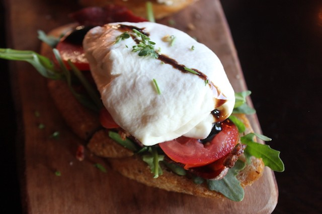 You'll have to knife-and-fork your burrata-topped bruschetta, but that's OK. - PHOTO BY SARAH FENSKE