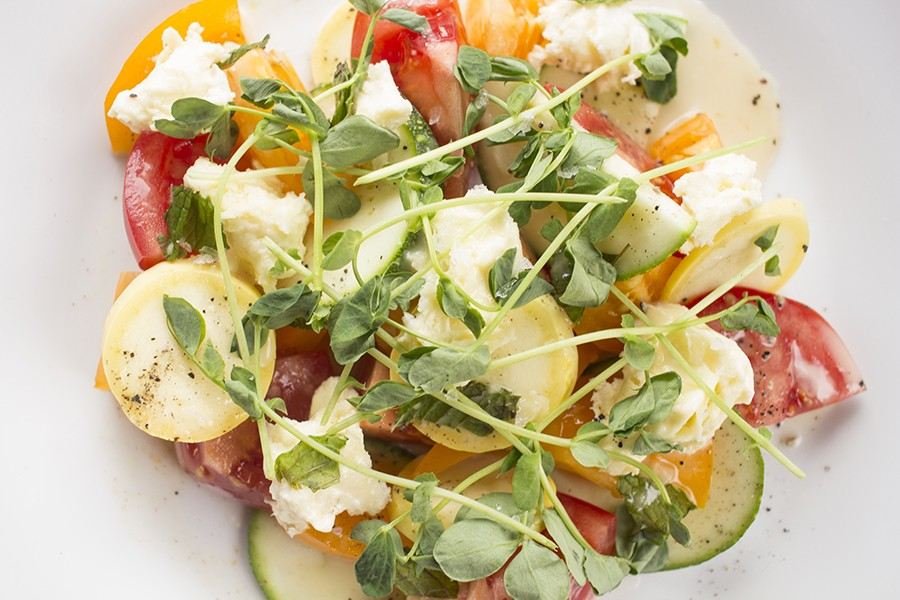 Snax offers seasonal vegetable salads, like this tomato and squash salad with mozzarella. - PHOTO BY MABEL SUEN