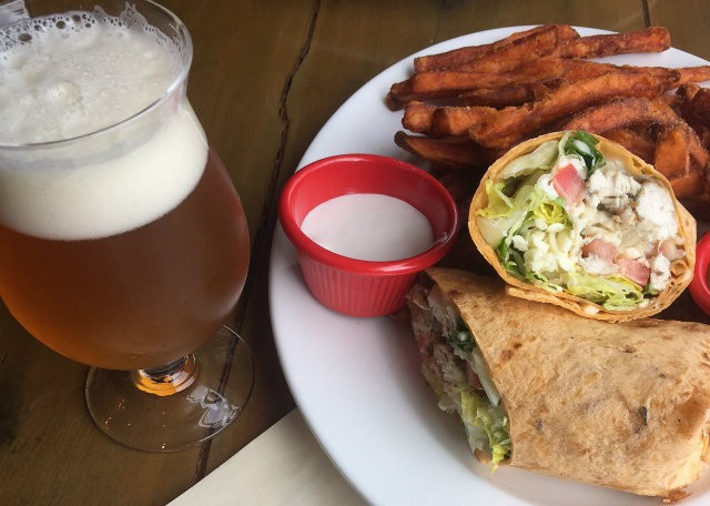 Third Wheel Brewing's chicken wrap with sweet potato fries. - PHOTO BY EMILY MCCARTER