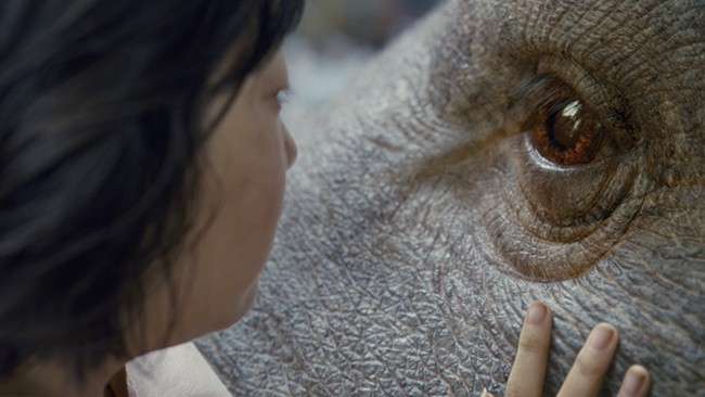 On the surface, Okja is a post-E.T. story of a child and her non-human friend, - (C) NETFLIX