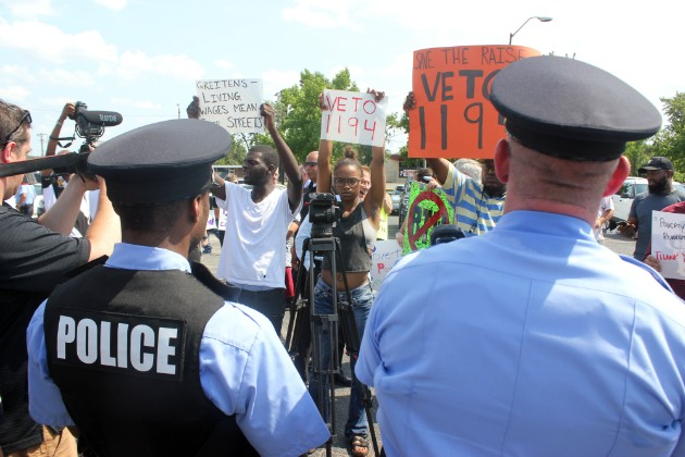 Protesters blast Greitens over legislation that will reverse St. Louis' minimum wage increase. - PHOTO BY DOYLE MURPHY