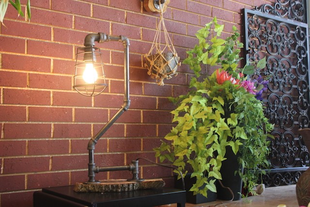Heit says she may start selling the striking pipe-based lamps she has on display at the store. - PHOTO BY SARAH FENSKE