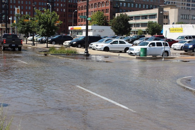 Water pooled in downtown St. Louis around 11:30 a.m. as a scorching heat wave continued. - PHOTO BY QUINN WILSON