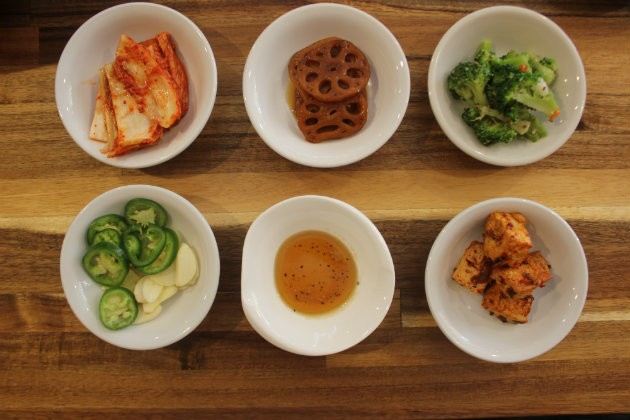 A selection of banchan, or complimentary side dishes. - CHERYL BAEHR