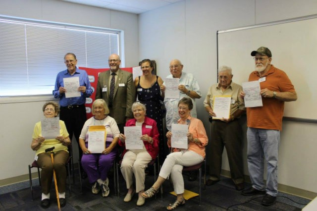 Eight pre-1941 adoptees were able to receive their birth certificates in August 2016 thanks to a new Missouri law. State Rep. Don Phillips is in the back. - COURTESY OF PATTI NAUMANN