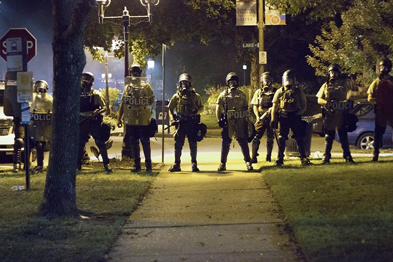 Before deploying tear gas, St. Louis cops in riot gear assembled at the intersection of Waterman Boulevard and Lake Avenue, about a block from Lyda Krewson's house. - PHOTO BY DANNY WICENTOWSKI