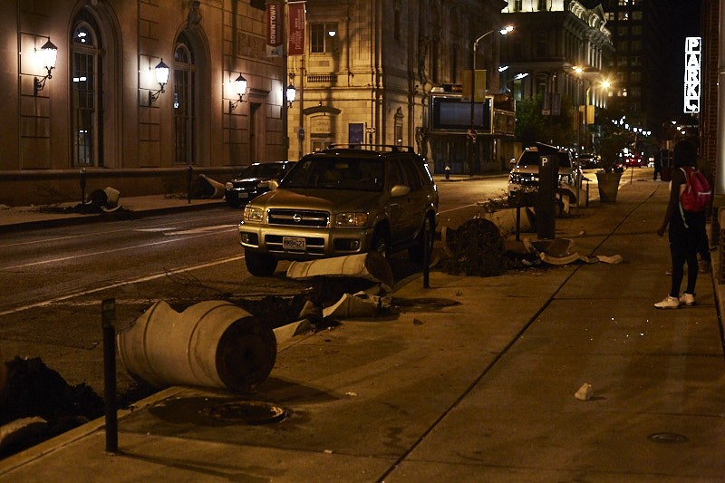 Broken flowerpots show the destruction downtown in the late night of Sunday, September 17. - PHOTO BY THEO WELLING