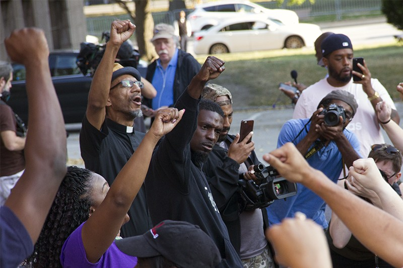 State Representative Bruce Franks Jr. leads protesters in a chant on the steps of St. Louis City Hall. - PHOTO BY DANNY WICENTOWSKI