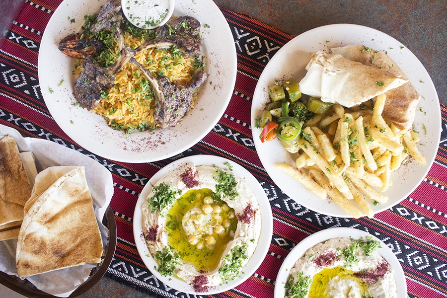 A selection of dishes from Albadia: lamb chops, chicken shawarma sandwich, hummus and baba ganoush. - PHOTO BY MABEL SUEN