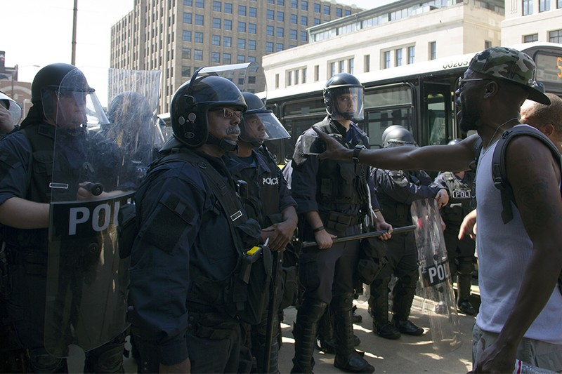 Police hold the line in downtown St. Louis. - PHOTO BY DANNY WICENTOWSKI