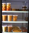 Containers of different soups are ready to heat and serve.