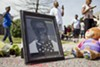 Protester Josh Williams' portrait had a place at Michael Brown's memorial.