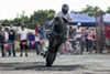 A rider pulls a wheelie during a 2013 Ride of the Century event in Columbia, Illinois.
