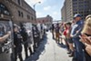 Protesters and police face off in downtown St. Louis on the afternoon of Friday, September 15.