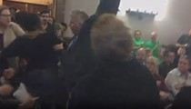 Skirmish Erupts Between Police Supporters, Protesters During Hearing