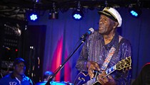 Chuck Berry Holding a Chuck Berry Bobblehead at Cardinals' Chuck Berry Night