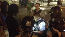 Chaotic Scene as St. Louis Cop Backs Through Protest Crowd (Video)