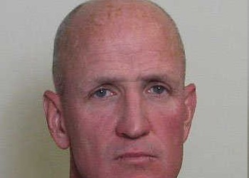 Michael Collins, Edwardsville Police Officer, Charged With Taping Women at Tanning Spa