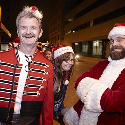 Saucy Santas Stream through Downtown