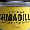 Malcolm eats a tin of armadillo. Hmmm, it tastes like salmon mousse.