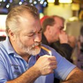 When sweeping smoking bans take effect next year, many bar patrons might not even notice the difference