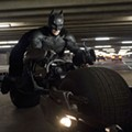 Self-important and overstuffed, <i>The Dark Knight Rises</i> feels like Batman forever