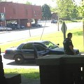 Google Street View Car Drives By As Cops Handcuff Man On The Ground in Belleville