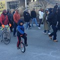 Photos: Eight-Year-Old Finn McNamee Marches on Unicycle in St. Louis MLK Parade