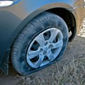 Carjacker Steals Nissan With Flat Tire While Owner Waits For AAA