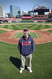 JENNIFER SILVERBERG - A sunny day at the office makes Cardinals head groundskeeper Bill Findley smile.