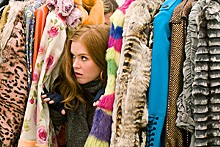 Rebecca Bloomwood (Isla Fisher) hides - her financial woes behind shameless - fashion plugs.