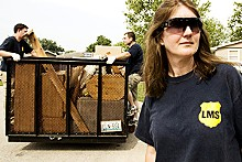 JENNIFER SILVERBERG - Laura Smith stands guard outside a recent eviction.