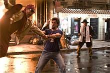 Zohan (Adam Sandler, right) gives Phantom (John Turturro, left) a free blow dry.