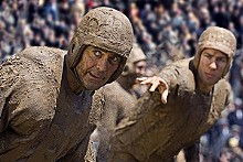 Play on words: There's a lot of talk but not much muddy action in Leatherheads.