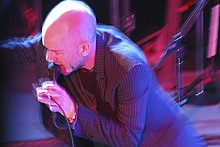 ANNIE ZALESKI - R.E.M. vocalist Michael Stipe accelerates at Stubb's BBQ during South by Southwest.