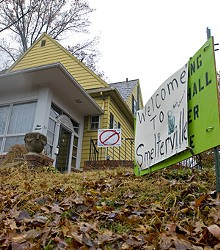 JENNIFER SILVERBERG - Signs of the time: Protest posters blanket lawns in Crystal City.