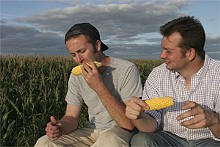 SAM CULLMAN - Holy crop! Ian Cheney and Curt Ellis sample the fruits of their labor from an acre of their farmland in Greene, Iowa.