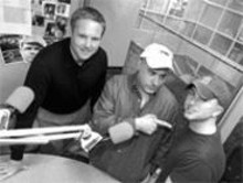 JENNIFER  SILVERBERG - Tim McKernan (right, with  co-hosts Martin Kilcoyne and Jim Hayes, in FSN ballcap) shed his coat and tie last February to focus on radio.