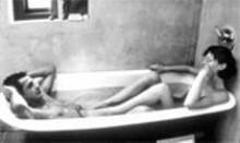 Rub-a-dub-dub: Kieran O' Brien (left) and Margo Stilley (right) get dirtily clean.