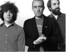 TAD  KUBLER - The many hairstyles of Ted Leo (center) and the - Pharmacists