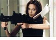 STEPHEN  VAUGHN/SMPSP - Killer looks: Angelina Jolie (pictured) and Brad Pitt - take aim at one another.