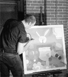 Charles Houska puts the finishing touches on some - lucky person's new painting.