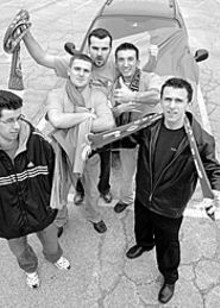 """ERIC  FOGELMAN - """"Suck on a dick, Chicago!"""" Sani Zigic (at far right) and - a handful of Fanaticos prep for a road trip to Chicago - to cheer on their beloved Steamers."""