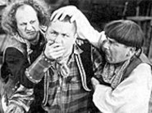 Larry and Moe check Curly's head for lumps before - deciding to administer same.