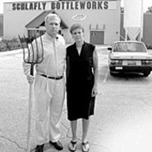 JENNIFER  SILVERBERG - Tom Schlafly stands in of his Maplewood bottling - facility with Ann Haubrich, member of the Art Outside - organizing committee.