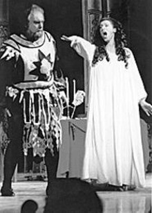 Rigoletto left the seat up again, and so he gets an - earful from his daughter, Gilda.